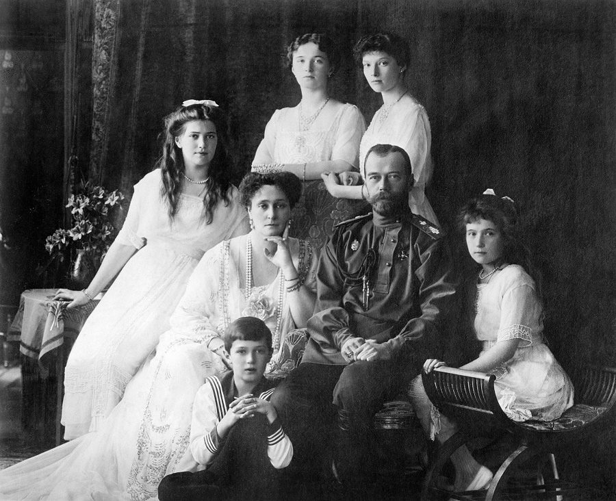 Photo shows members of the Romanovs, the last royal family of Russia including: seated (left to right) Marie, Queen Alexandra, Czar Nicholas II, Anastasia, Alexei (front), and standing (left to right), Olga and Tatiana. (Source: Flickr Commons project, 2010)